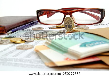 Still-life with the exchange graph coins and banknotes. - stock photo