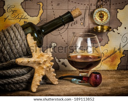 Still life with things leisure and travel on a background of map - stock photo