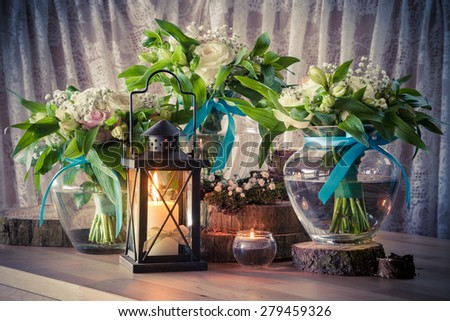 Still life with three wedding bouquets and candles, vintage stylized. - stock photo