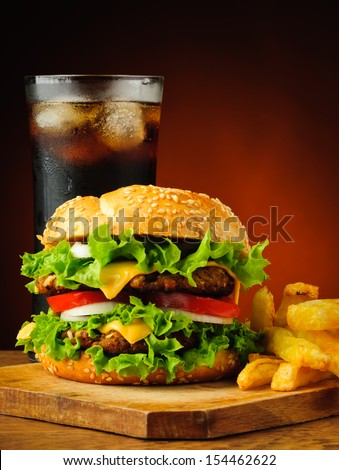 still life with traditional hamburger, french fries potatoes and cola drink - stock photo
