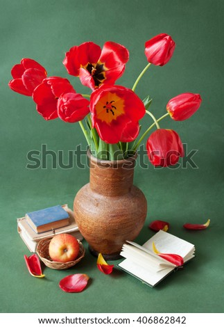 Still life with tulip flowers, apple and books isolated on white background. Teacher's day concept - stock photo