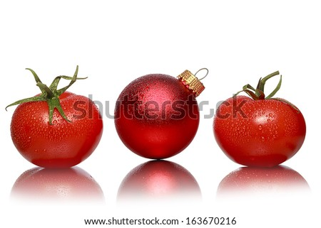 still life with two tomatoes and one red christmas ball, isolated on white.