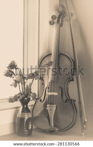 Still life with vintage violin - stock photo