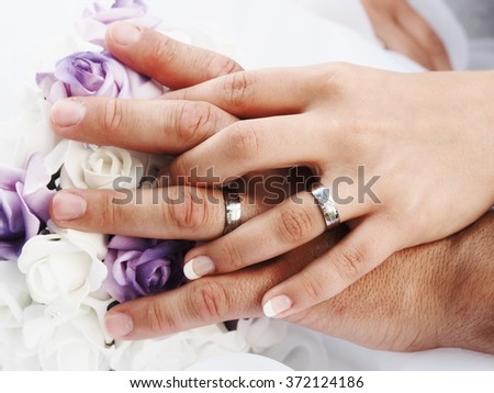 still life with wedding bouquet and wedding rings