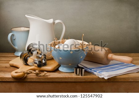 Still life with white eggs on wooden table - stock photo