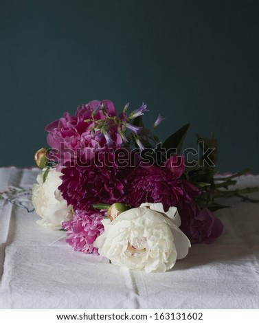 Still life with white peonies in vase