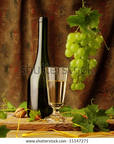 Still life with wine and hanging grape - stock photo
