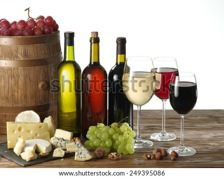 Still-life with wine, cheeses and fruits on a white background. - stock photo