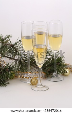 Still-life with wine glasses with champagne and gold spheres, a New Year's still-life