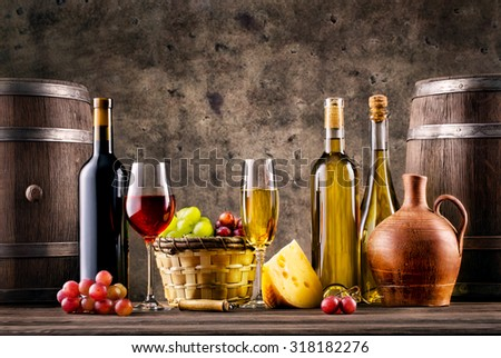 Still life with wine, grapes, barrels and cheese on grunge background - stock photo