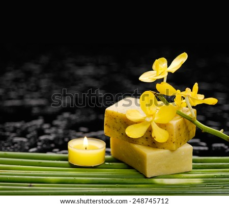 Still life with yellow orchid with long leaf and candle ,soap  - stock photo