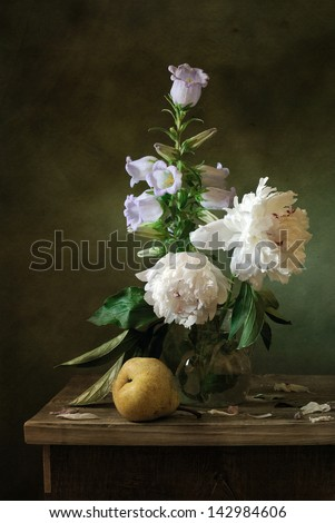 Still life wth peonies and a pear - stock photo