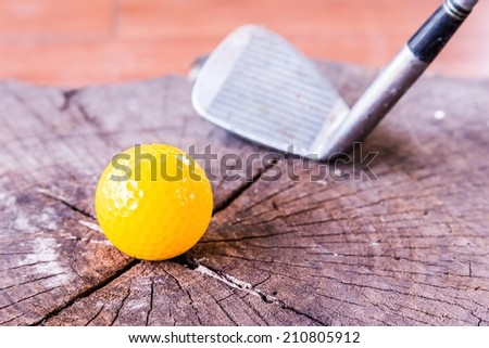 Still life Yellow Miniature Golf Ball On White Background. - stock photo
