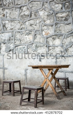 stilllife of Old rustic table and chair