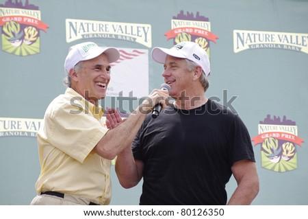 STILLWATER, MN - JUNE 19: Race announcer Michael Aisner(L) speaks with Greg LeMond(R) before kicking off start of Stillwater Criterium at Nature Valley Grand Prix on June 19, 2011, in Stillwater, MN - stock photo