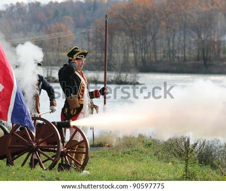 STILLWATER,NY, USA - NOV 6: Colonial soldiers fire a canon at British Soldiers at the annual Battle of Saratoga Reenactment on November 6, 2010 in Stillwater, NY, USA - stock photo