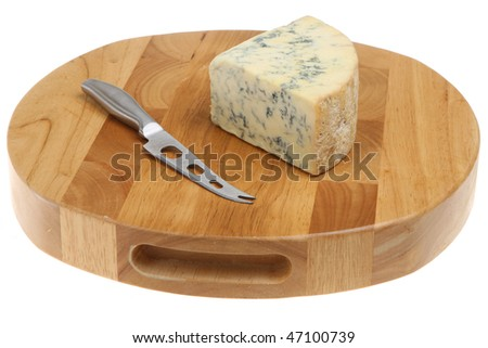 Stilton cheese on a cheeseboard - stock photo