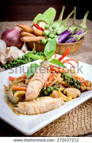 stir fish with spicy curry on table - stock photo