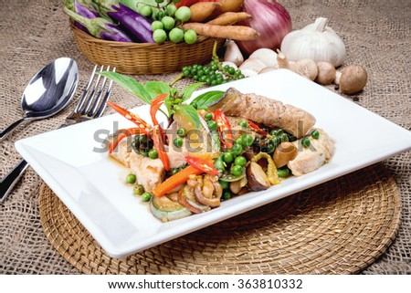 stir fish with spicy curry on table, thai food. - stock photo