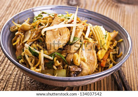 stir fried chicken and noodles - stock photo