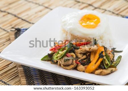 stir fried chicken whit basil on rice. - stock photo