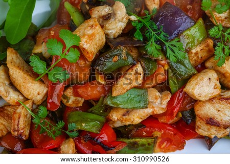 Stir fried chicken with vegetables, herbs and spices