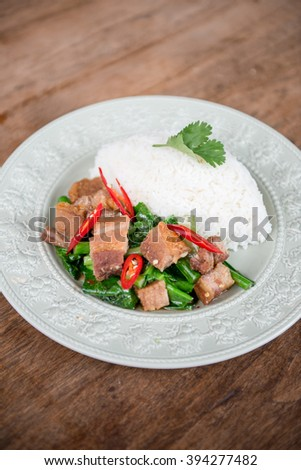 Stir fried crispy pork with jasmine rice. - stock photo