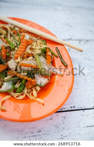 Stir fried egg noodles with chicken. Traditional khmer cuisine. - stock photo