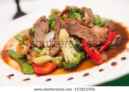 Stir fried grill duck with black pepper. - stock photo