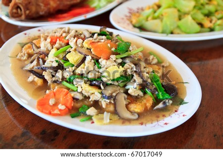Stir fried mix vegetables in Brown and Deep fried Tofu in Brown
