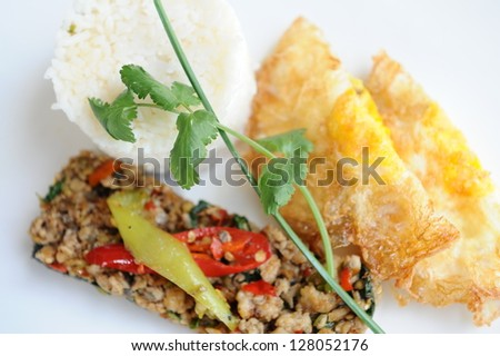 stir fried pork with basil and egg served with rice