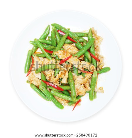 stir fried pork with yard long bean  and red curry on white plate, top view