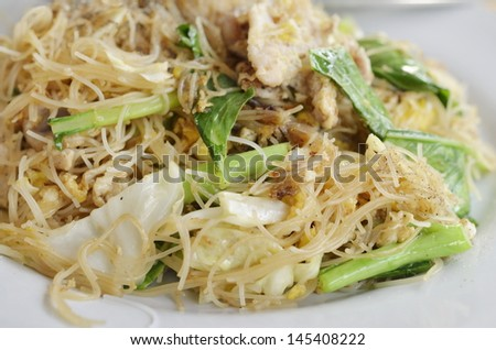 Stir Fried Rice Noodle with egg, pork and vegetable, Thai food