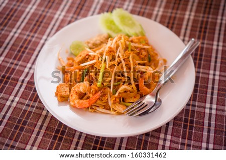Stir-fried rice noodles  with shrimps - Pad Thai - stock photo