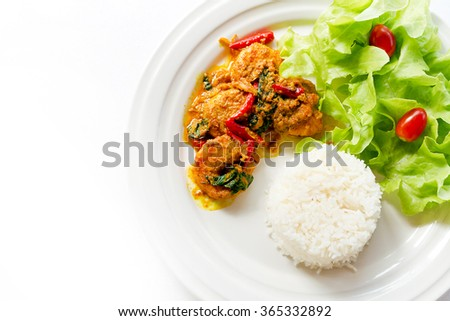 stir fried shrimp in thai red curry paste with rice and fried egg , Spicy Fried Shrimp , Curry fried shrimps and cooked rice in white dish closeup on table , Fried stir shrimp with red curry - stock photo