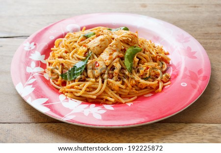 Stir Fried Spicy Spaghetti with Chicken in Chilli paste - stock photo