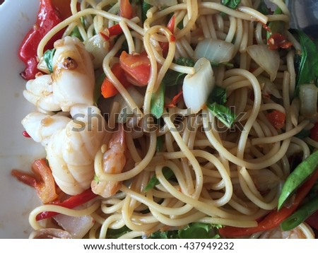 stir-fried spicy spaghetti with seafood. thai style. Spaghetti seafood with spicy. stir-fried spicy pasta with seafood - stock photo