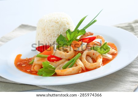 Stir fried squid with salted egg yolk over rice, Thai food - stock photo