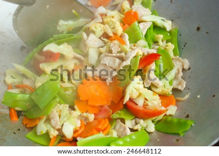 stir fried vegetables in a chinese wok - stock photo