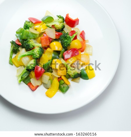 stir fried vegetables in white dish - stock photo