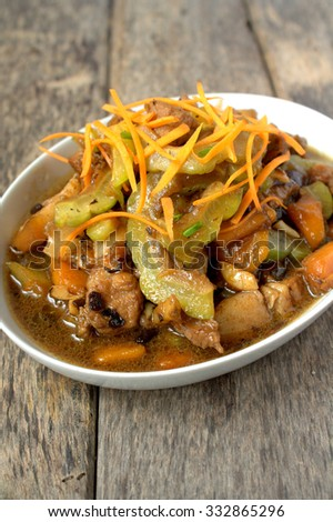 Stir Fry Bitter gourd with pork, carrot and salted black bean - Famous Chinese Cuisine - stock photo