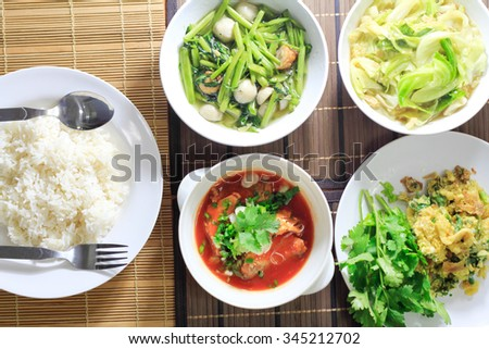 Stir Fry Cabbage with rice on dinner table, soft focus - stock photo