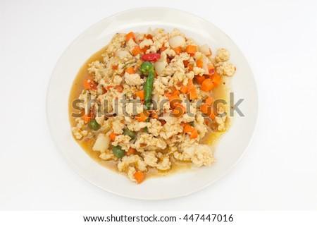 Stir fry chicken with spicy ingredient, Thai food - stock photo