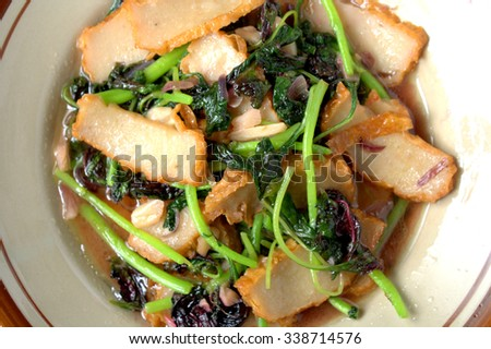 Stir fry Chinese amaranth or bayam. cooked with slice fish cake