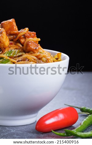 Stir Fry Noodles with Fresh Chili Peppers on the Side - stock photo
