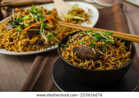 Stir Fry Singapore Noodles, with bio herbs and microgreens, vegetable - stock photo