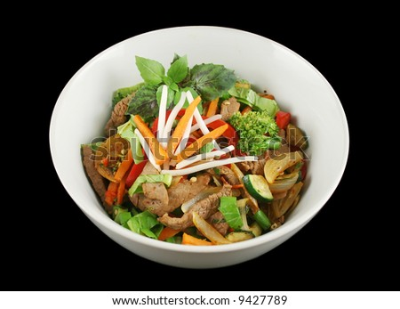 Stirfry beef and vegetables witha purple green basil garnish. - stock photo