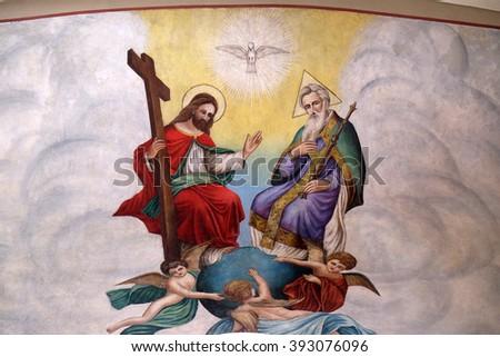 STITAR, CROATIA - AUGUST 27: Holy Trinity, fresco in the church of Saint Matthew in Stitar, Croatia on August 27, 2015 - stock photo