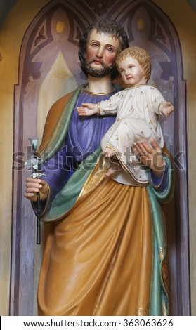 STITAR, CROATIA - AUGUST 27: St. Joseph holding baby Jesus, altar of St. Anthony the Great in the church of Saint Matthew in Stitar, Croatia on August 27, 2015 - stock photo