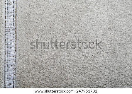 Stitched suede can be used as a background - stock photo
